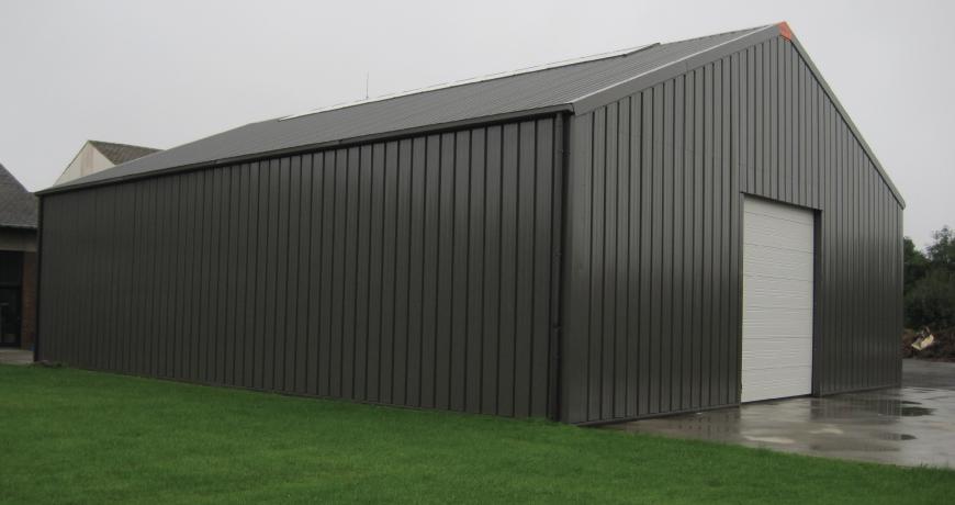 An exterior of a gray Frisomat Metal Hall